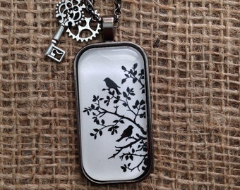 Black and white birds in a tree rectangular pendant.  Gunmetal pendant tray and image under glass.