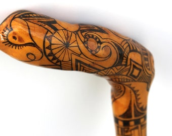 """One of a kind  36"""" wood burned walking cane with abstract design."""