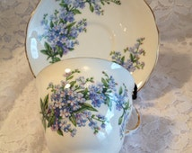 Queen Anne Bone China, Forget-Me-Not Pattern, Made in England, A Product of Ridgway Potteries, Ltd, Footed Tea Cup with Gold Trim.