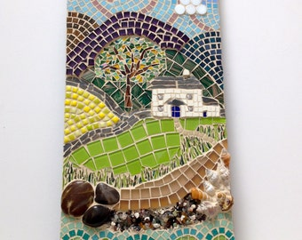 Set in the Silver Sea. Mosaic artwork. Seaside country cottage in mixed media.