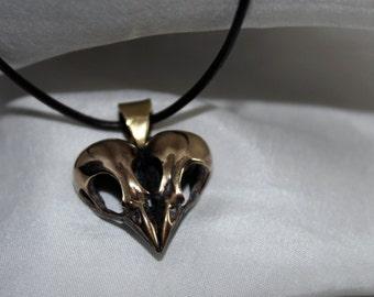 Double bird skull heart pendant