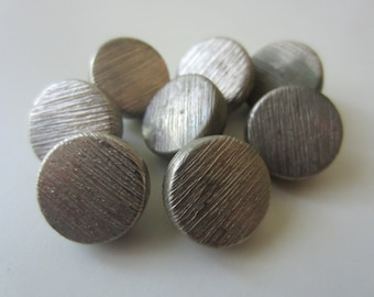 Vintage buttons. 7 Novelty antique  brushed silver matching lot of   7 (333)