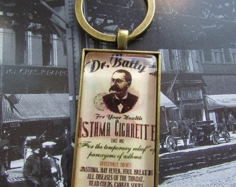 Keychain Vintage Advertisement Asthma Cigarettes under Polished Glass in Brass Setting