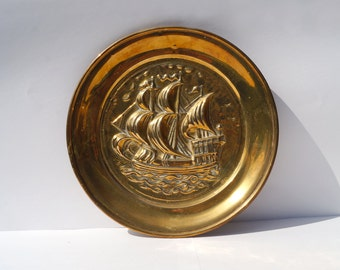Vintage Brass Plaque / wall hanging    a ship / boat in a sea