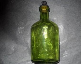 Green Vintage Royal Lyme Bottle. Made in England