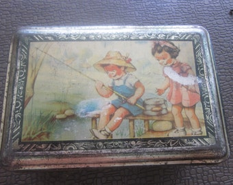 box in steel  two children who fish are painting on