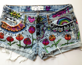 "recycled denim, hand-painted shorts: ""flower power"" tatooed. wearable art. by artfink."
