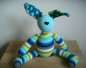 Sweet crocheted stuffed rabbit in cheerful colors