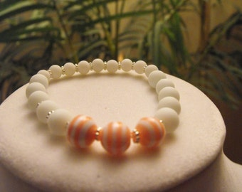 "Pink and white striped stretch bracelet fits 6-1/2"" to 8"" wrist"
