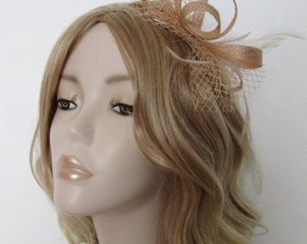 BEIGE SAND FASCINATOR, Made of sinamay, net and Feathers, on comb