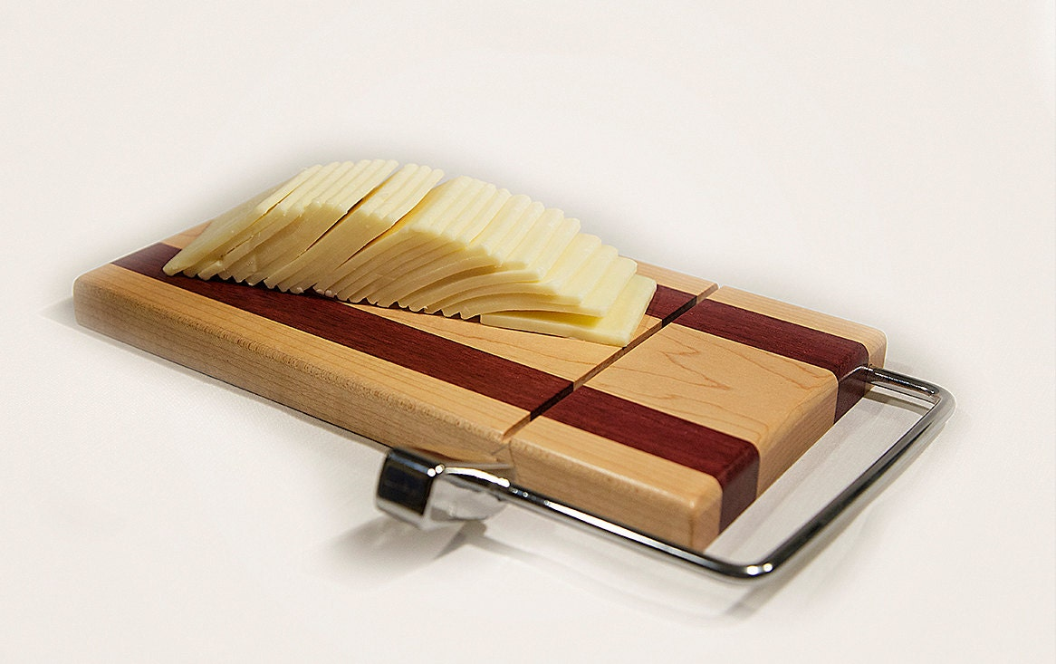 Wooden cheese board with slicer