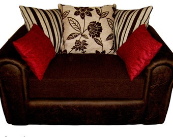Barcelona Cuddle Chair Upholstered In A Brown Faux Suede And Brown/Cream Scatter Cushions