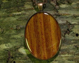 Real Quartered Eucalyptus wood, resin encased in antique bronze finish pendant bezel with chain