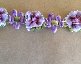 Violet and olive flower trim.