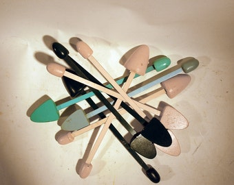 nine 9 shoe stretchers wood and metal painted pink, teal, baby blue and forest green