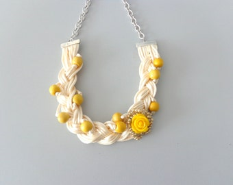White yellow flower and gold braided necklace