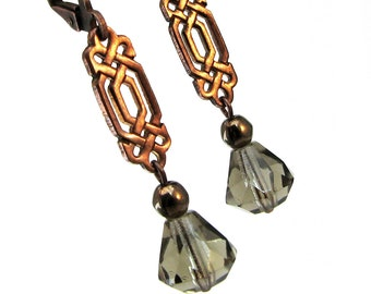 Celtic style dangle earring in antique copper with topaz grey glass beads