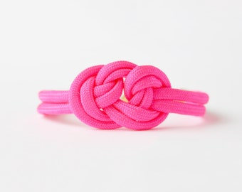 Neon hot pink adjustable triple knot parachute cord nautical rope bracelet with petite gold anchor charm