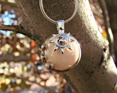Sun Crystal - Pearl Colored Glass Pendant it comes with your choice of chain