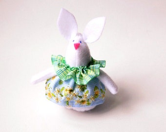 Felt Rabbit Ornament or Door Hanger sewn in white felt wearing a dress in blue, yellow and green