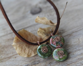 Unakite triangle pendant with spirals.