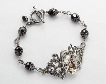 Steampunk Bracelet Vintage Waltham watch movement gears, silver filigree flower jet black crystal beaded bracelet by Steampunk Nation