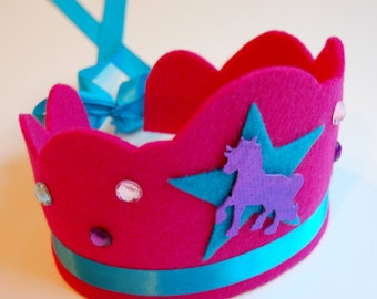 3 left! limited edition lorelei unicorn felt crown with turquoise star, sparkly gemstones, and adjustable ribbon tie.  party, play, imagine.