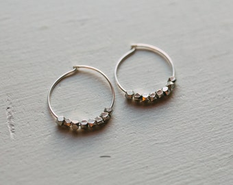 Silver hoop earrings with African beads.