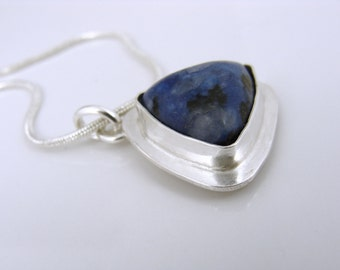 Sterling silver trillion pendant with dark blue stone