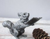 Silver Plate Squirrel Holding Music Book