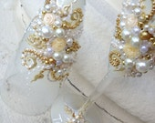 Elegant wedding champagne glasses, hand decorated with roses and pearls, in ivory, white and gold