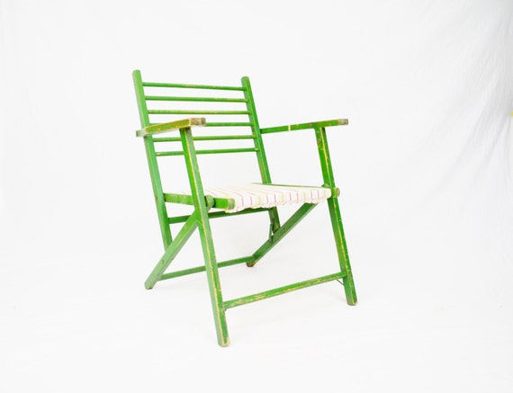 green wooden folding chair with cloth striped seat