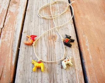 Vintage wooden carved animal beads on hemp adjustable cord