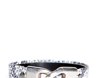 Printed leather bracelet and a silver plated hook clasp.