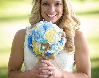 Romantic rustic sunny yellow, blue, ivory and burlap bridal wedding bouquet. Shabby chic fabric flowers.