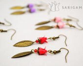 Origami jewelry - Hane earrings, a feather and an origami lotus handfolded.