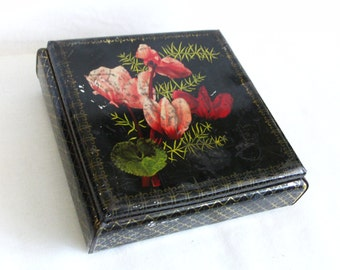 Square vintage tin box. Poppy flowers, Red on Black. Sleep, peace, remembrance symbol. Flanders, poppies. Old shabby container. litho, decor