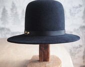Charlie II: Sturdy men's weight  felt with tall rounded crown and flat brim with matching leather trim and two antique brass studs