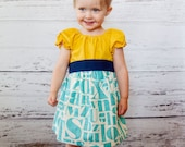 Mustard Yellow Turquoise Alphabet Peasant Dress With Sash - Baby Girl
