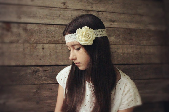 Three in one: corsage, necklace or headband. Wear it, as you like it.  Ivory  rose.