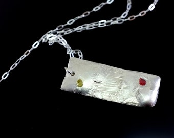 Organic Silver Pendant with Red and Yellow Rough Sapphire