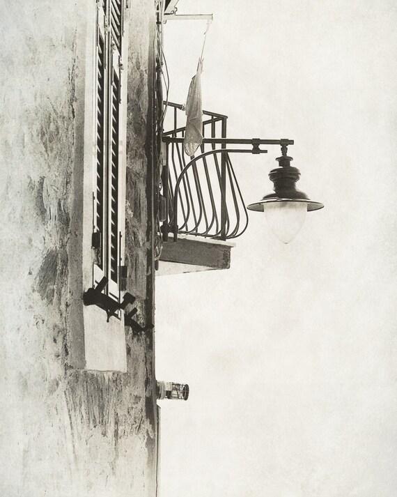 Tellaro Window, Balcony, and Street Light. Italy. Monochrome Photography. Black & White Print by OneFrameStories.
