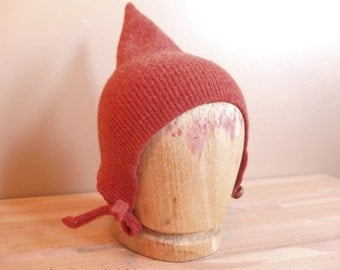 Pixie hat made from felted wool,  burnt orange with a vintage button