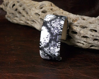 Native American Beaded Cuff Bracelet In The Colors Of  Black And White Snake Skin by LJ Greywolf