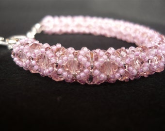 Swarovski rose bracelet with pink roccaille and very bright, elegant and impressive