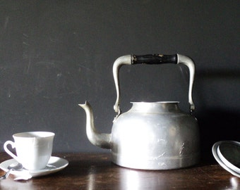 60 years old aluminum Kettle with wood handle