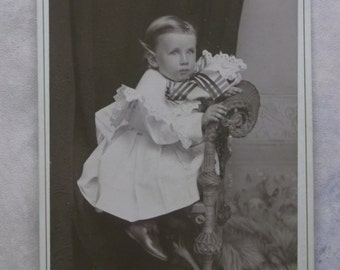 Cute Little Boy in Ruffled White Dress - Huge Bow - Wicker - Antique Cabinet Photo - Knoxville, TN