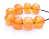 Pearly bright orange handmade lampwork bead set of 8 curvy cube shaped glass beads in startling orange