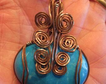 Blue Sodalite cabachon pendant in Copper wire