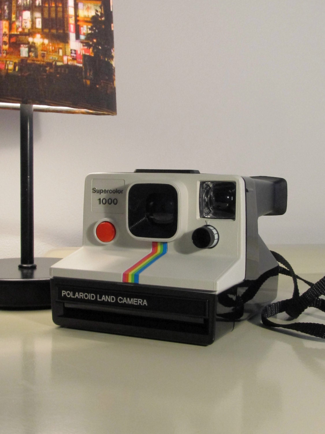 polaroid camera 1000 supercolor rainbow land camera sx 70. Black Bedroom Furniture Sets. Home Design Ideas